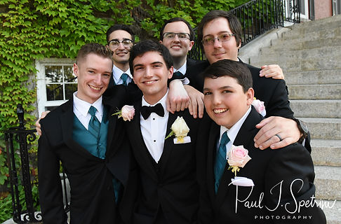 Brian poses for a photo with his groomsmen following his June 2018 wedding ceremony at the College of the Holy Cross in Worcester, Massachusetts.