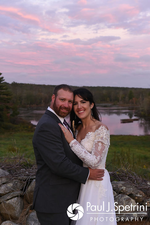 Samantha and Dale pose for a formal photo during sunset prior to their October 2017 wedding reception at the Golden Lamb Buttery in Brooklyn, Connecticut.