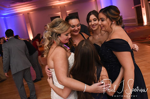 Sarah hugs her friends during her October 2018 wedding reception at The Omni Hotel in Providence, Rhode Island.