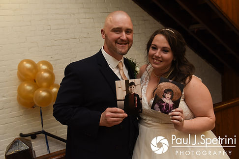 Meridith and Matthew hold photos from their childhood following their May 2017 wedding reception at the Hope Artiste Village in Pawtucket, Rhode Island.