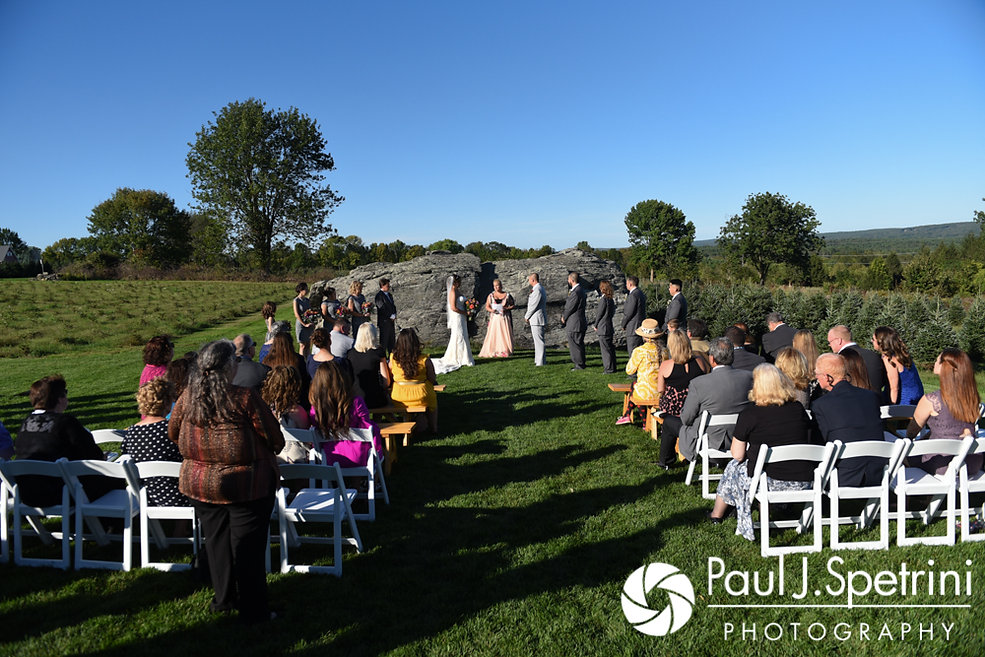 Jennifer and Kevin listen to their officiant during their September 2017 wedding ceremony at Allen Hill Farm in Brooklyn, Connecticut.