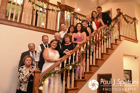Toni and Scott pose for a formal photo with family members during their August 2017 wedding reception at Crystal Lake Golf Club in Mapleville, Rhode Island.