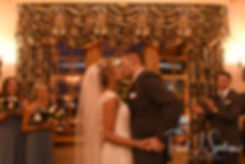 Nicole and Kurt kiss during their November 2018 wedding ceremony at the Publick House Historic Inn in Sturbridge, Massachusetts.