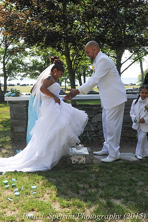Jean Andrade uses a step stool to kiss her new husband.