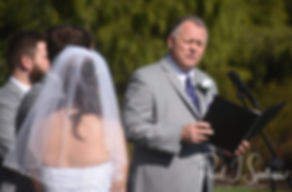 Sam's father reads a passage during Sam and Katie's April 2018 wedding ceremony at Quidnessett Country Club in North Kingstown, Rhode Island.
