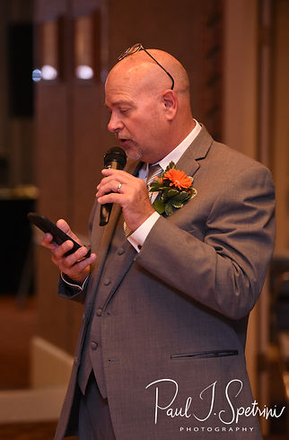 The groom's father gives a blessing during Justine & Jon''s October 2018 wedding reception at Twelve Acres in Smithfield, Rhode Island.