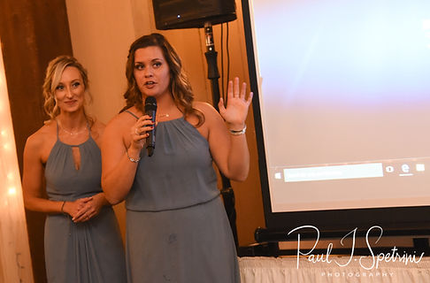 Two bridesmaids unveil a surprise slideshow during Nicole & Kurt''s November 2018 wedding reception at the Publick House Historic Inn in Sturbridge, Massachusetts.