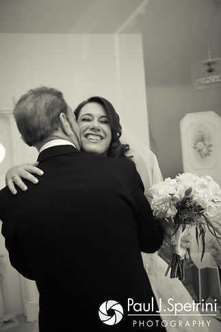 Brooke and her father embrace prior to her October 2016 wedding ceremony at The Farm at SummitWynds in Jefferson, Massachusetts.