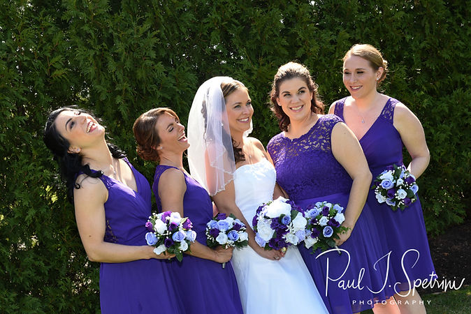 Katie pose for a formal photo with her bridesmaids prior to her April 2018 wedding ceremony at Quidnessett Country Club in North Kingstown, Rhode Island.