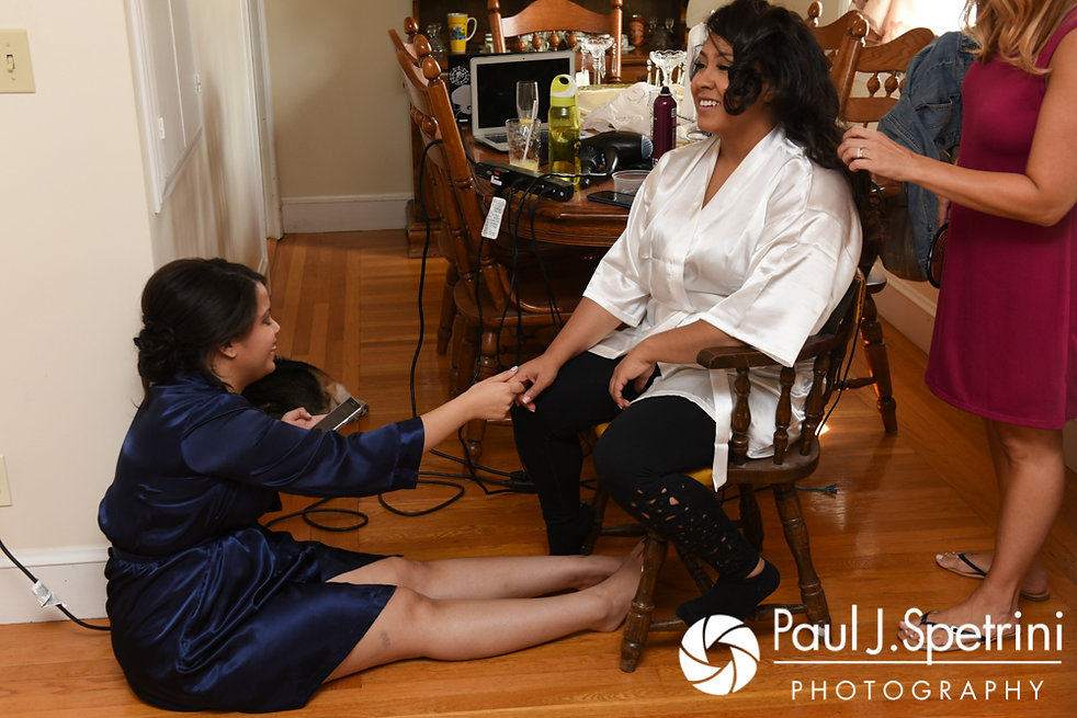 Stephany holds hands with her sister prior to her September 2017 wedding ceremony at Wannamoisett Country Club in Rumford, Rhode Island.