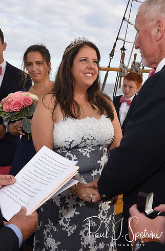 Kate looks at Mike during her May 2018 wedding ceremony aboard the Schooner Aurora boat in the waters off Newport, Rhode Island.