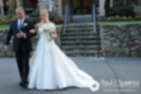 Laura walks with her father during her September 2017 wedding ceremony at Lake of Isles Golf Club in North Stonington, Connecticut.
