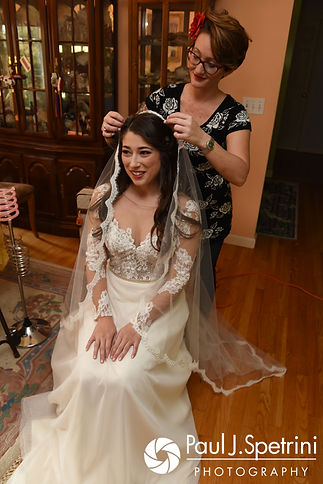 Jessica has her veil placed in her hair prior to her October 2017 wedding ceremony at the Assumption of the Blessed Virgin Mary Church in Providence, Rhode Island.