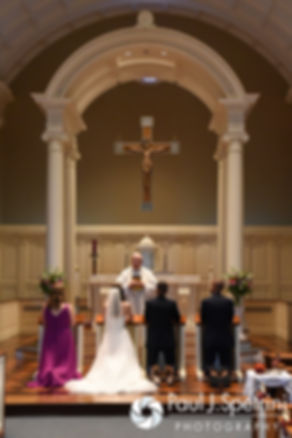 Alex and Alyssa kneel during their August 2016 wedding ceremony at Holy Name Church in Fall River, Massachusetts.