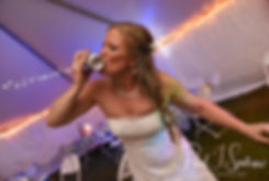 Kim shotguns a beer during her September 2018 wedding reception at their home in Coventry, Rhode Island.