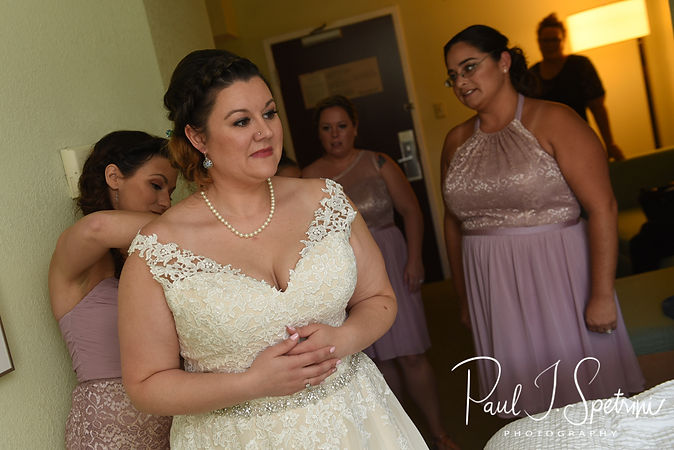 Ashley has her dress zipped up prior to her September 2018 wedding ceremony at Stepping Stone Ranch in West Greenwich, Rhode Island.