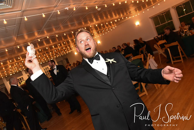 Brandon gets ready to toss the garter during his November 2018 wedding reception at the North Beach Clubhouse in Narragansett, Rhode Island.