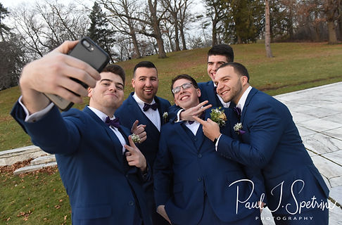 Mack poses for a formal photo with his groomsmen at Roger Williams Park in Providence, Rhode Island prior to their December 2018 wedding reception at Independence Harbor in Assonet, Massachusetts.