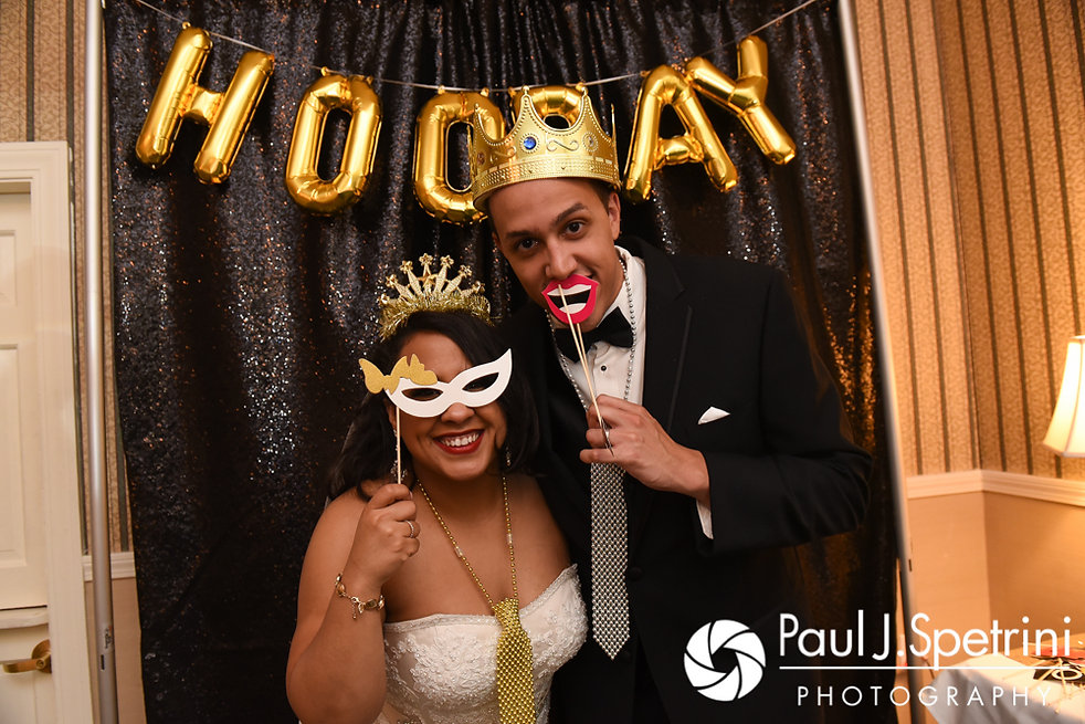 Stephany and Arten pose for a photo during their September 2017 wedding reception at Wannamoisett Country Club in Rumford, Rhode Island.