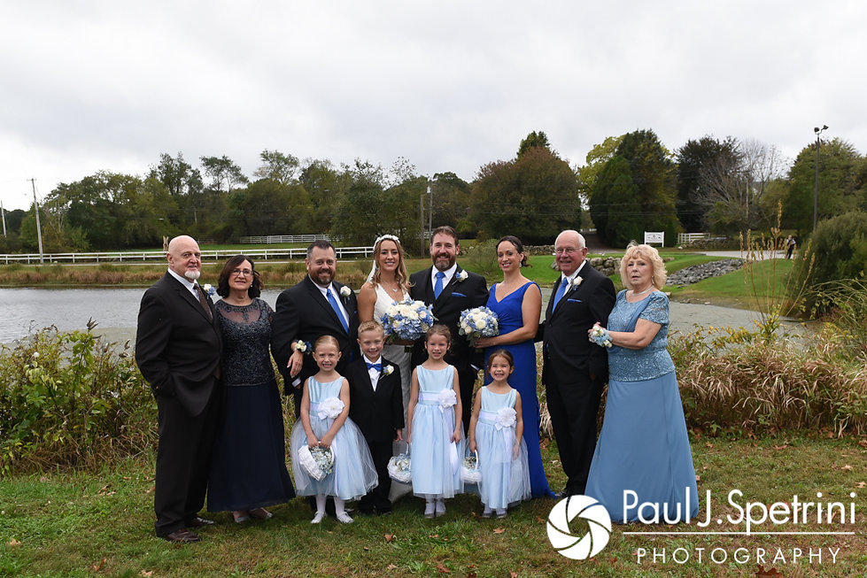 Kevin and Joanna pose for a formal photo with family members following their October 2017 wedding ceremony at Cranston Country Club in Cranston, Rhode Island.