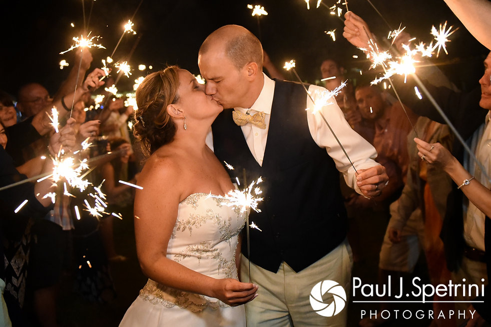 Rebecca and Kelly kiss during a sparkler exit during their August 2017 wedding reception in Warwick, Rhode Island.