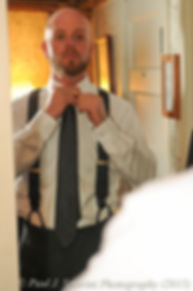 Mike fixes his tie prior to his November 2015 wedding at the Publick House in Sturbridge, Massachusetts.