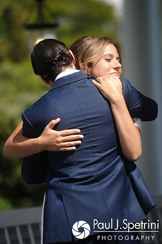 Jennifer and Bruce hug during a first look prior to their August 2017 wedding ceremony at The Inn at Mystic in Mystic, Connecticut.