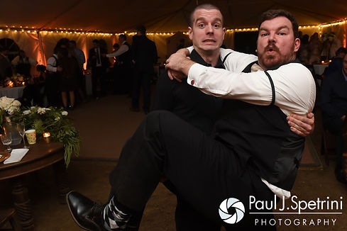 JD and his officiant pose for a photo during his October 2016 wedding reception at The Farm at SummitWynds in Jefferson, Massachusetts.