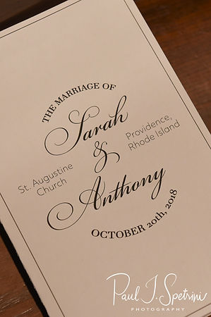 A program is shown on display prior to Sarah & Anthony's October 2018 wedding ceremony at St. Augustine Catholic Church in Providence, Rhode island.