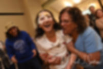 Amanda's niece laughs during Amanda & Josh''s October 2018 wedding reception at Loon Pond Lodge in Lakeville, Massachusetts.