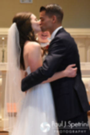 Alyssa and Alex share their first kiss as husband and wife during their August 2016 wedding ceremony at Holy Name Church in Fall River, Massachusetts.