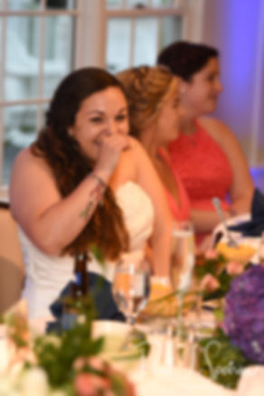Laura laughs as her maid of honor gives a speech during her June 2018 wedding reception at Independence Harbor in Assonet, Massachusetts.