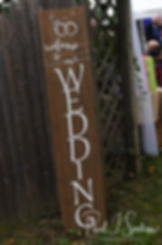 A sign is on display prior to Josh & Kim's September 2018 wedding ceremony at their home in Coventry, Rhode Island.