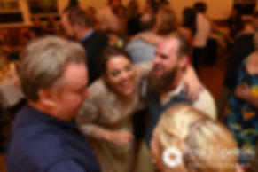 Arielle and Gary celebrate with guests during their September 2017 wedding reception at North Beach Club House in Narragansett, Rhode Island.