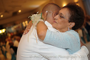 Joe Andrade dances with his mom at his wedding.