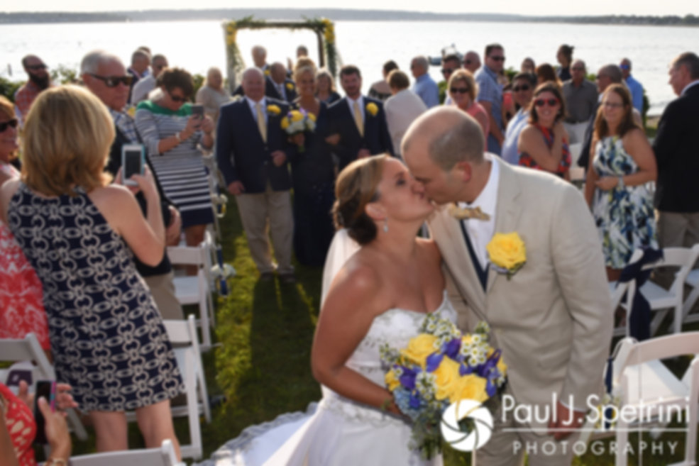 Rebecca and Kelly kiss during their August 2017 wedding ceremony in Warwick, Rhode Island.