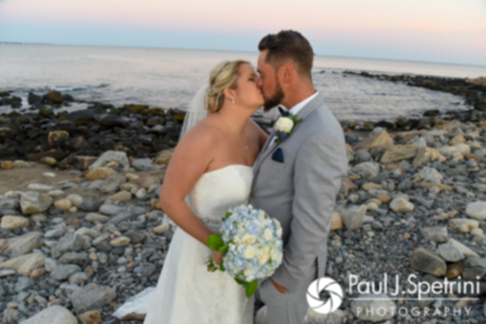 Jennifer and Robert kiss for a formal photo following their September 2017 wedding ceremony at Gazebo Park in Narragansett, Rhode Island.