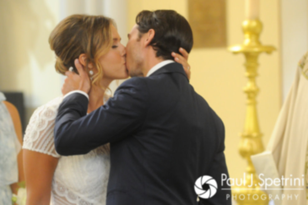 Jennifer and Bruce share their first kiss during their August 2017 wedding ceremony at St. Joseph Church in New London, Connecticut.