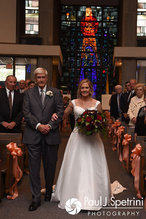 Tricia and her father walk down the aisle during her October 2017 wedding ceremony at St. Brendan Parish in Riverside, Rhode Island.