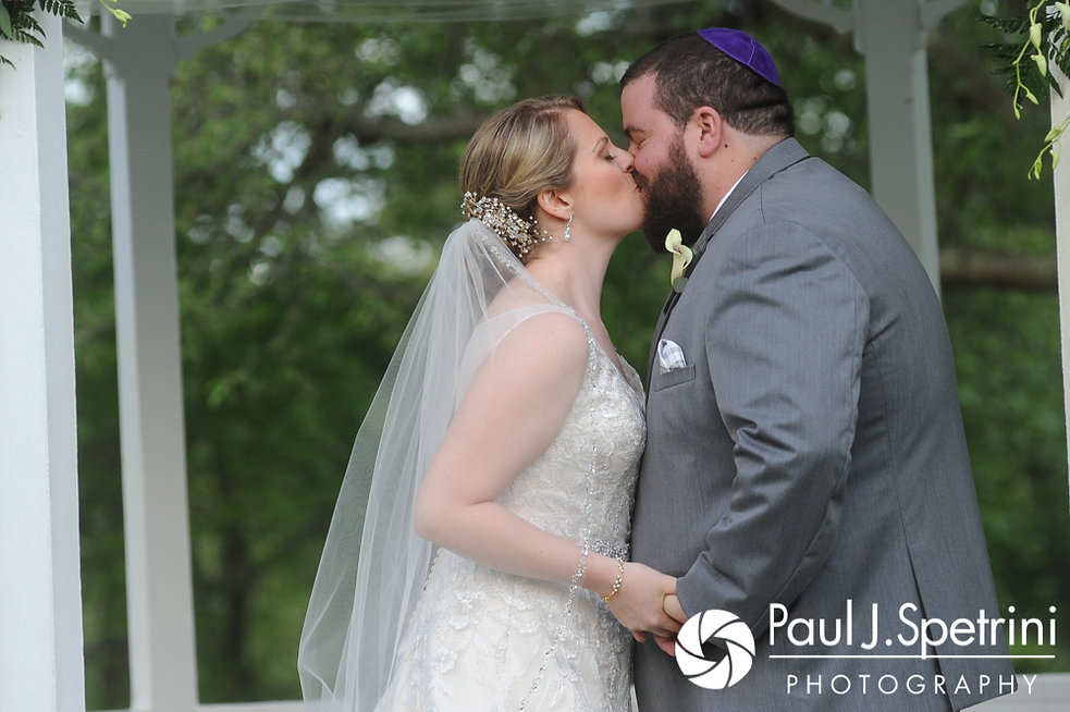 Melissa and Jordan share their first kiss during their May 2017 wedding ceremony at Independence Harbor in Assonet, Massachusetts.