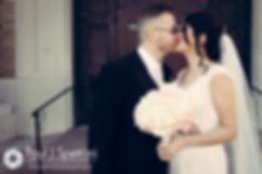 Maria and Sebastian share a kiss after their March 2016 Rhode Island Wedding.