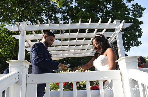 Jimmy and Saken participate in a sand ceremony during their July 2018 wedding ceremony at Lake Pearl in Wrentham, Massachusetts.