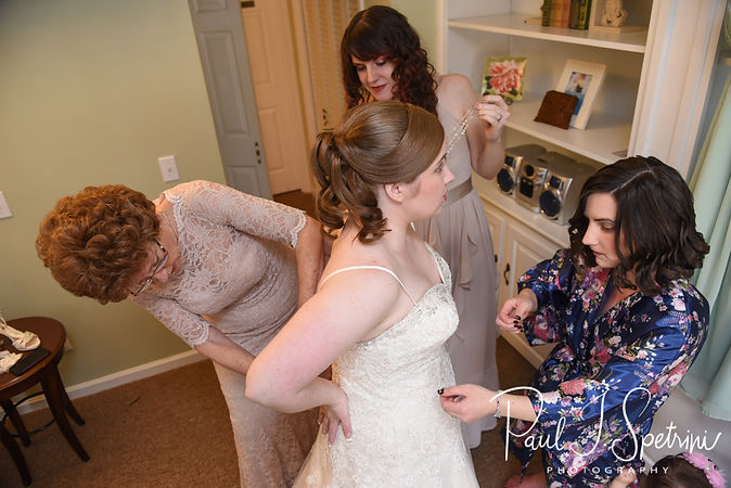 Kaytii has her dress zipped up prior to her May 2018 wedding ceremony at Meadowbrook Inn in Charlestown, Rhode Island.