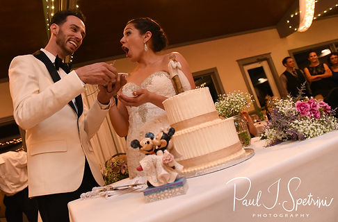 Kendra and Joe cut the cake during their May 2018 wedding reception at Crystal Lake Golf Club in Mapleville, Rhode Island.