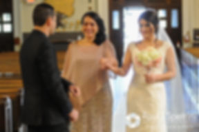 Maria's mother hands her off to her brother as they all walk down the aisle during Maria and Sebastian's March 2016 Rhode Island wedding at the Church of St. John the Baptist in Pawtucket, Rhode Island.