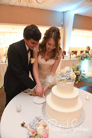 Brian and Sarah cut the cake during their June 2018 wedding reception at Pleasant Valley Country Club in Sutton, Massachusetts.