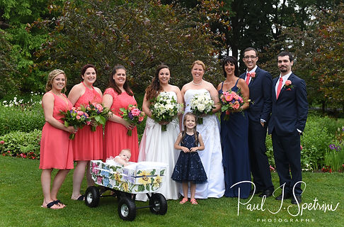 Laura & Marijke pose for a formal photo with their wedding party following their June 2018 wedding ceremony at Independence Harbor in Assonet, Massachusetts.