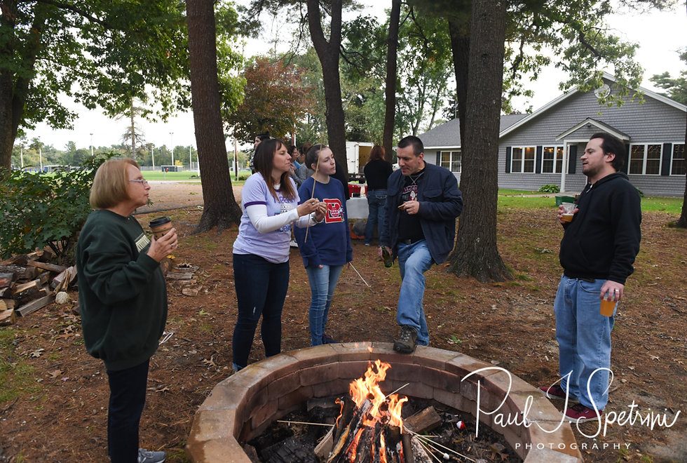 Guests make smores during Amanda & Josh''s October 2018 wedding reception at Loon Pond Lodge in Lakeville, Massachusetts.