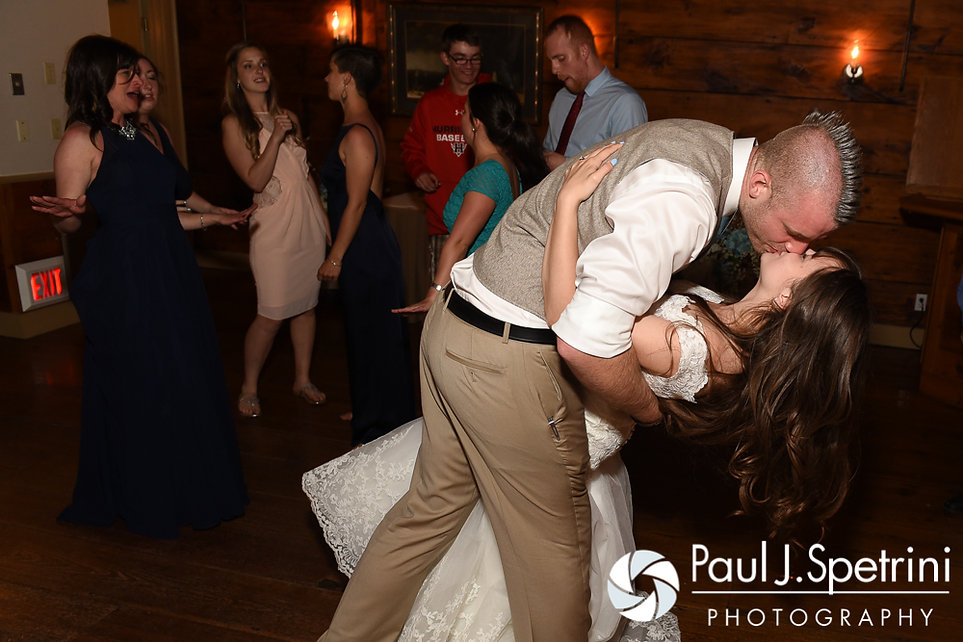 Krystal and Ian kiss during their May 2016 wedding reception at DeWolf Tavern in Bristol, Rhode Island.
