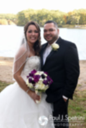 Stephanie and Henry smile for a formal photo prior to their October 2016 wedding reception at Lake Pearl Luciano's in Wrentham, Massachusetts.